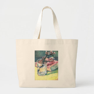 Blossoming Almond Branch in a glass and a book Large Tote Bag