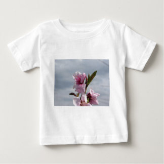 Blossoming peach tree against the cloudy sky baby T-Shirt