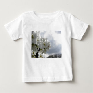 Blossoming pear tree against the cloudy sky baby T-Shirt