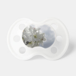 Blossoming pear tree against the cloudy sky pacifier
