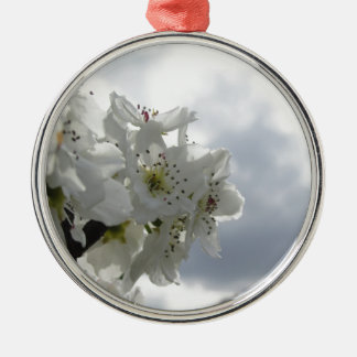 Blossoming pear tree against the cloudy sky Silver-Colored round ornament