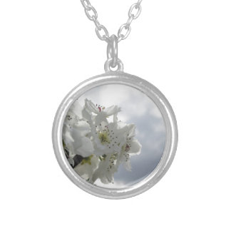 Blossoming pear tree against the cloudy sky silver plated necklace