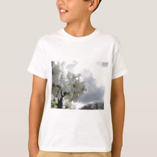 Blossoming pear tree against the cloudy sky T-Shirt