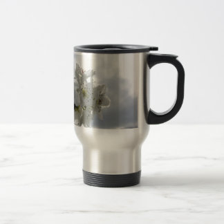 Blossoming pear tree against the cloudy sky travel mug