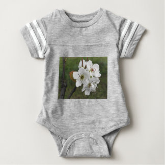 Blossoming pear tree against the green garden baby bodysuit