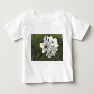 Blossoming pear tree against the green garden baby T-Shirt