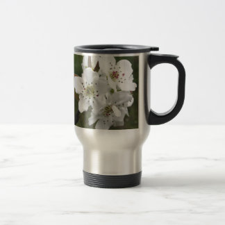 Blossoming pear tree against the green garden travel mug