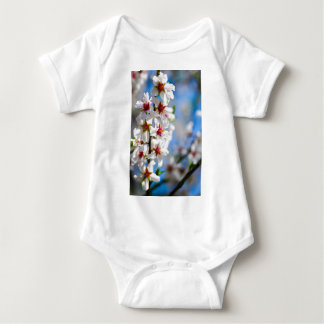 Blossoming tree branch with white flowers baby bodysuit