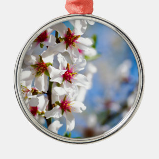 Blossoming tree branch with white flowers metal ornament