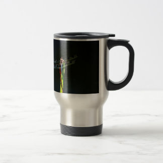 Blue and black  Dragonfly on green and red grass Travel Mug