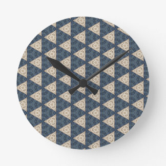 blue and taupe triangles round clock