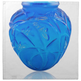 Blue Art Deco glass vase with grasshopper design. Napkin