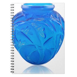 Blue Art Deco glass vase with grasshopper design. Notebooks