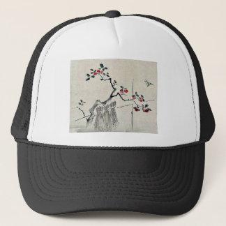 Blue bird on a branch of a fruit tree trucker hat