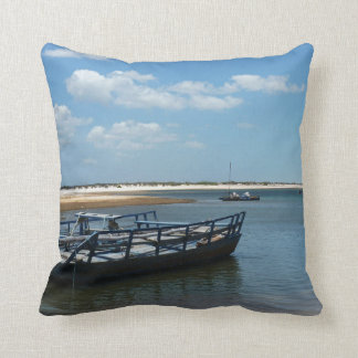Blue boat waiting for tourists throw pillow