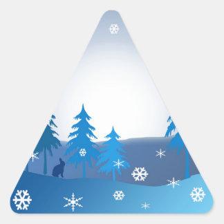 Blue christmas winter scene triangle sticker