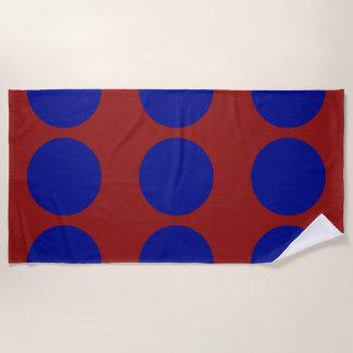 Blue Circles on Red Beach Towel