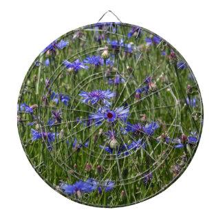 Blue cornflowers in a field dartboard