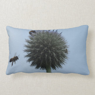 Blue cushion with bee in flight photograph