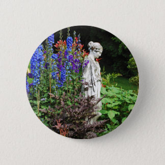 Blue delphinium flower garden and statue 2 inch round button