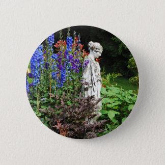 Blue delphinium flower garden and statue 2 inch round button