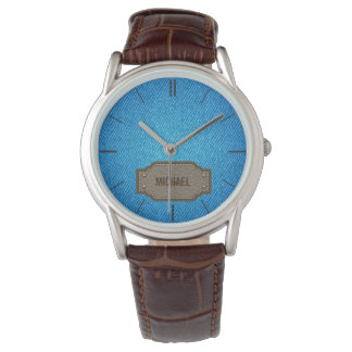 Blue denim jeans with leather name label wristwatches