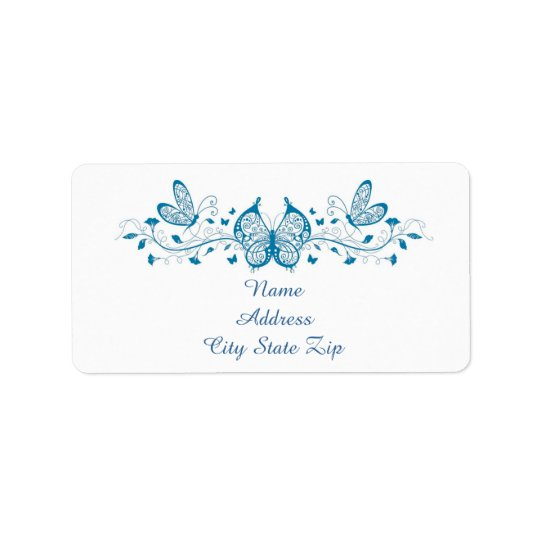 Blue filigree butterflies  and flowers label