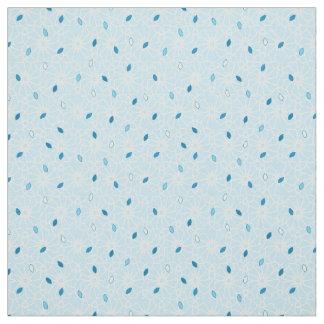 Blue flecks cascading over a simple floral back fabric