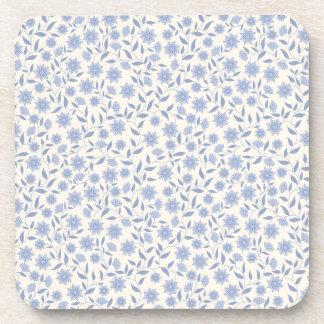 Blue flowers on white pattern coaster