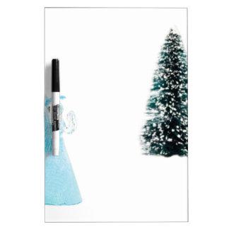 Blue glass angel praying near christmas tree dry erase board