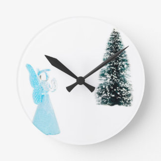 Blue glass angel praying near christmas tree wall clock