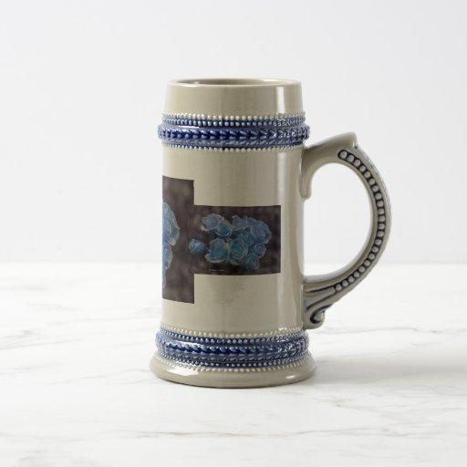 Blue glowing roses against a dark background mug