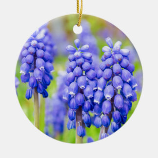Blue grape hyacinths round ceramic ornament