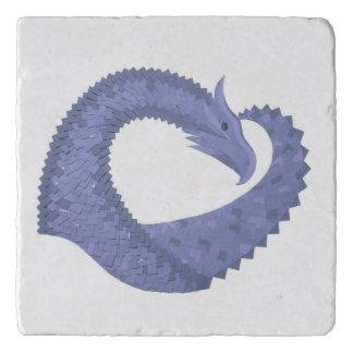 Blue-grey heart dragon on white trivet