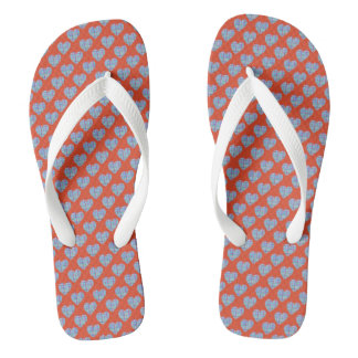 Blue hearts on warm red flip flops