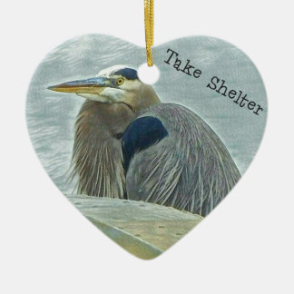 blue heron sheltering from wind behind boat on lak ceramic heart ornament