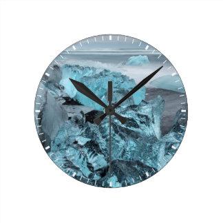 Blue ice on beach seascape, Iceland Clock