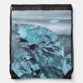 Blue ice on beach seascape, Iceland Drawstring Bag
