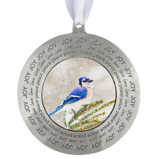 Blue jay in a pine tree with snow pewter ornament