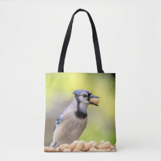 Blue jay with a peanut tote bag