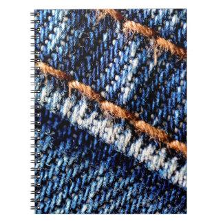 Blue jeans closeup texture. spiral note book
