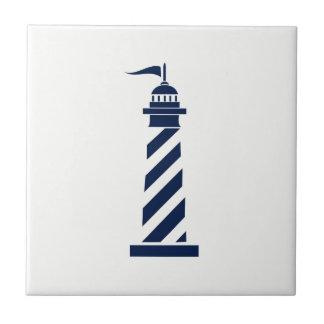 Blue Lighthouse on White Ceramic Tile