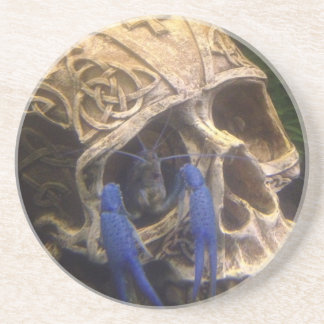 Blue lobster crayfish hanging out in a skull eye coaster