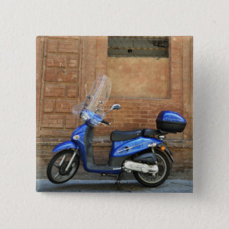Blue motor scooter by red wall, Siena, Italy 2 Inch Square Button