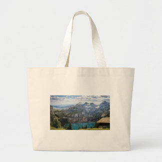 Blue mountain lake  oeschinen pond in nature large tote bag