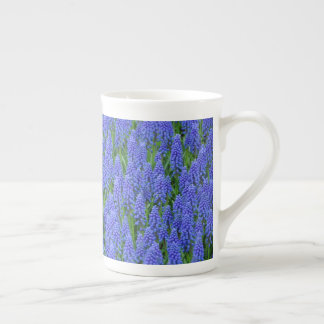 Blue muscari flowers tea cup