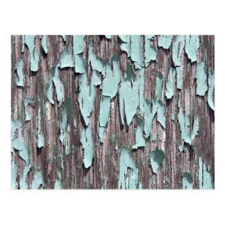 Blue peeling paint on wood postcard