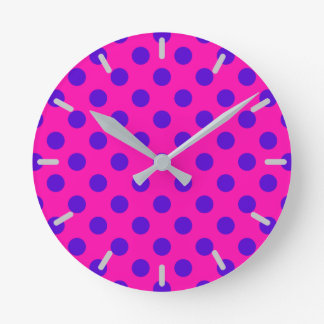 Blue polka dots on fuchsia wall clocks