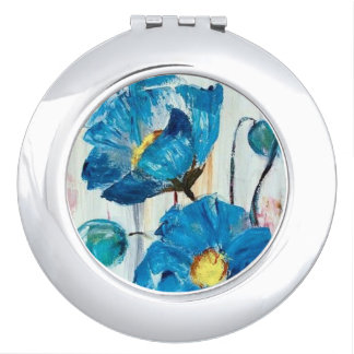 Blue poppies on compact mirror