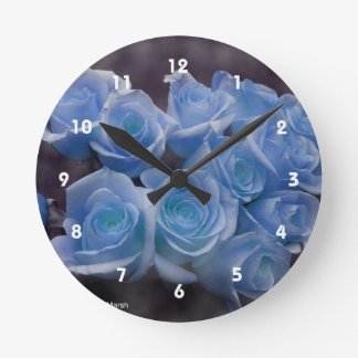 Blue Rose colorized bouquet spotted background Round Clock